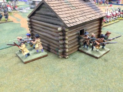 Holed up Loyalist Militia.  In Wilderness Wars you can not shoot at units in a building with small arms.  You need a cannon or burn them out.